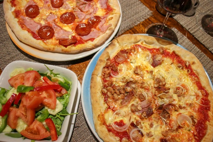 Pizzas and salad at Galija Pizzeria in Split, Croatia