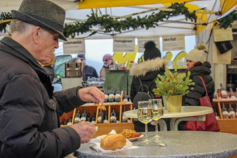 Old man eating at Bauernmarkt Konstablerwache market in Frankfurt, Germany