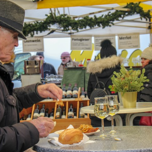Old man eating at Bauernmarkt Konstablerwache market in Frankfurt, Germany