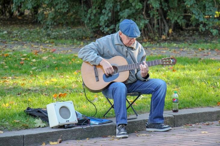 Man plays guitar at Ivan Franko Park in Lviv, Ukraine
