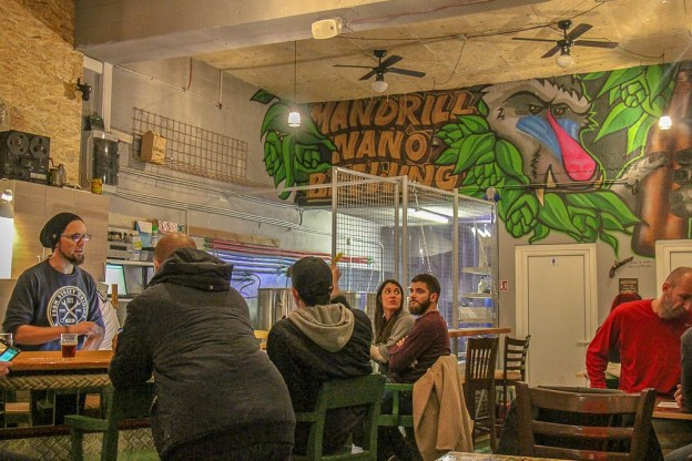 People drinking beer at Mandrill Nano-Brewery bar in Split, Croatia