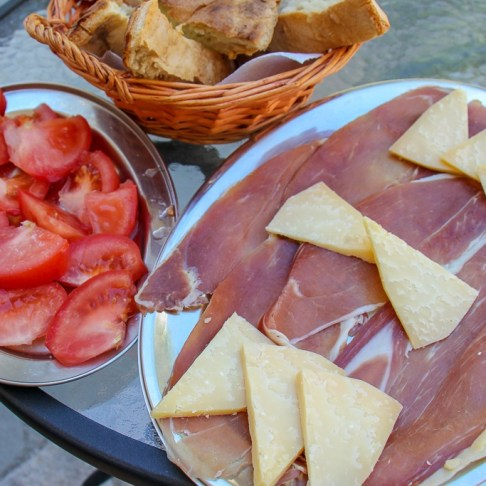 Local meat and cheese platter with homegrown tomatoes in Split, Croatia