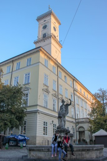 The Neptune Statue in front of Town Hall Clock Tower on Rynok Square in Lviv, Ukraine
