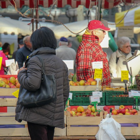 Shopper looks at prodcue at Bauernmarkt Konstablerwache market in Frankfurt, Germany