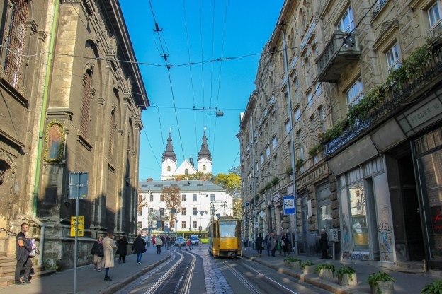 Looking down Ruska Street at tram and the St. Michael the Archangel Church in Lviv, Ukraine
