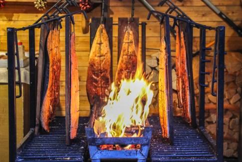 Fire-smoked fish at Christmas Market in Frankfurt, Germany