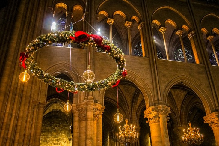 Decorative advent wreath hangs in Notre Dame Cathedral at Christmastime in Paris, France
