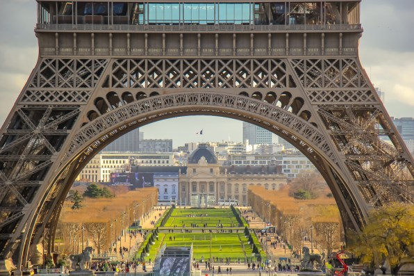Looking through the Eiffel Tower to Champs de Mars in Paris, France