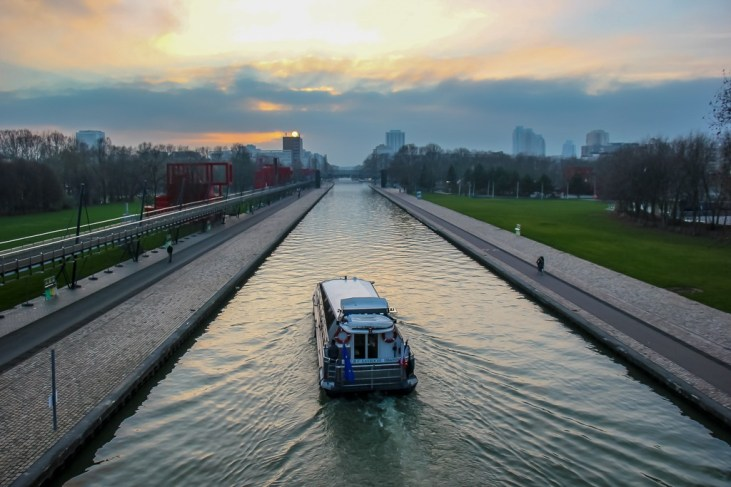 Ferry boat on Canal Saint-Martin in Paris, France