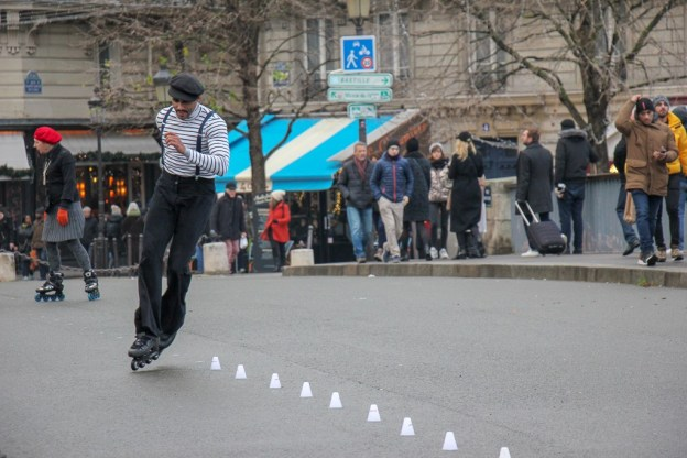 Street performer on roller skates in Paris, France