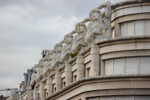 Statues part of building architecture in Paris, France