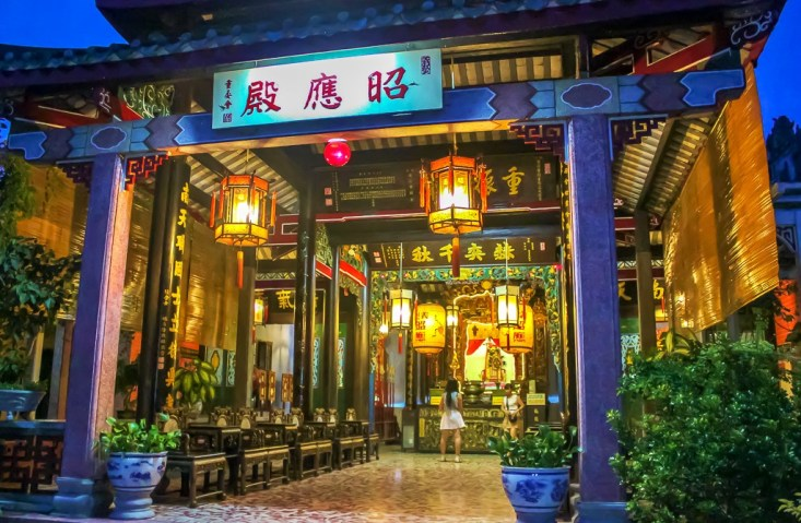 Temple illuminated at night in Hoi An, Vietnam
