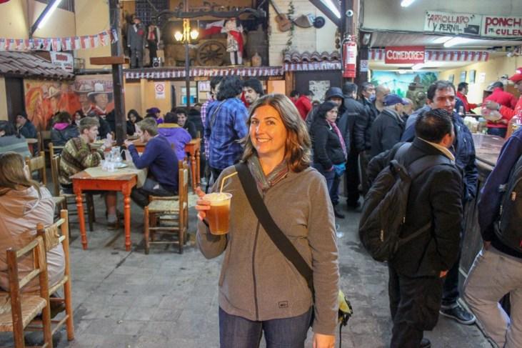 Drinking Torremoto at La Piojera in Santiago, Chile