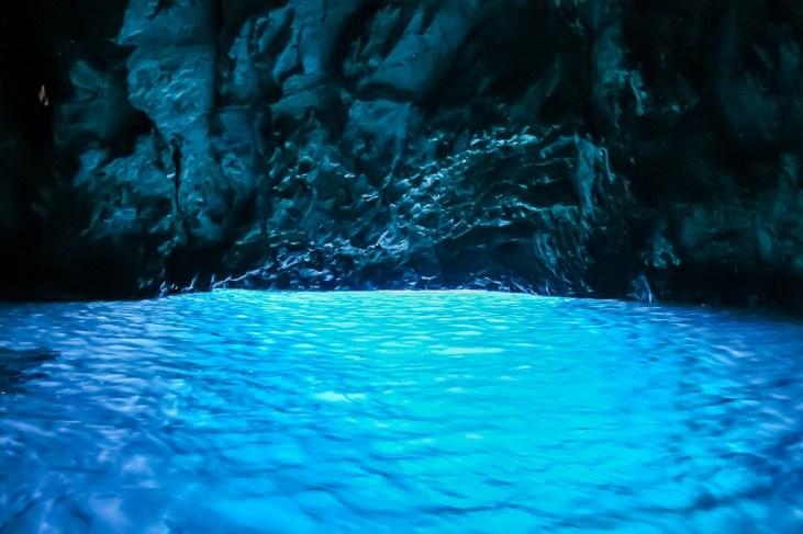 Neon blue water in Blue Cave in Croatia