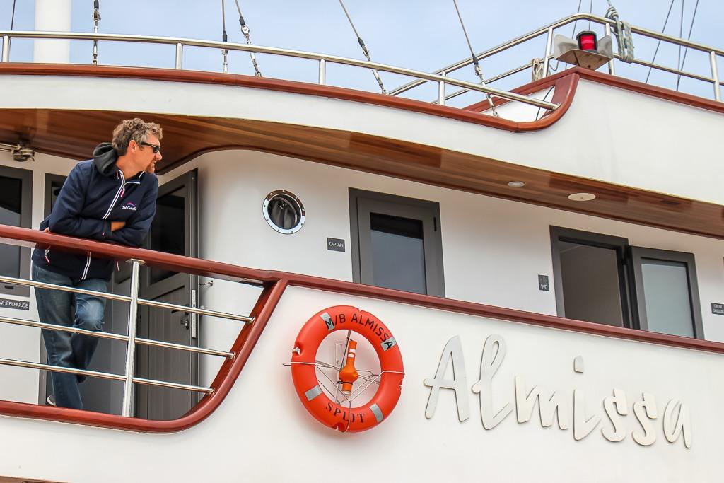 Captain Jure stands aboard the Almissa on Sail Croatia Explorer Cruise