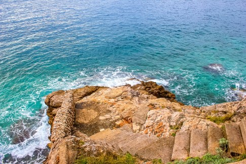 Stairs leading into water in Dubrovnik, Croatia