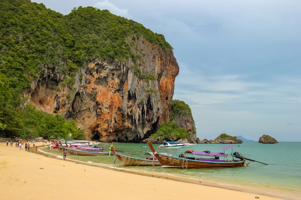 Longtail boats line the beach in Railay West, Thailand