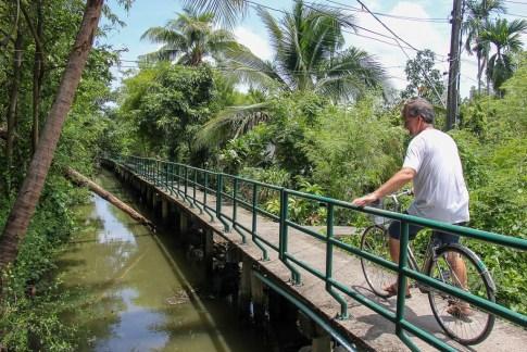 Man bikes along elevated path on Bang Kachao Island in Bangkok, Thailand