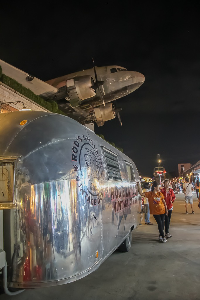 Air stream trailer and historic plane on display at the Night Train Market in Bangkok, Thailand