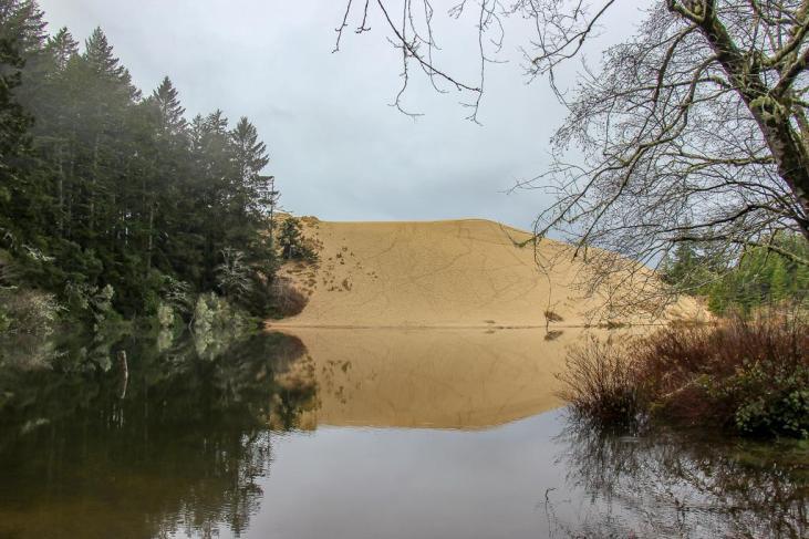 Sand dunes across Hall Lake on Oregon Coast