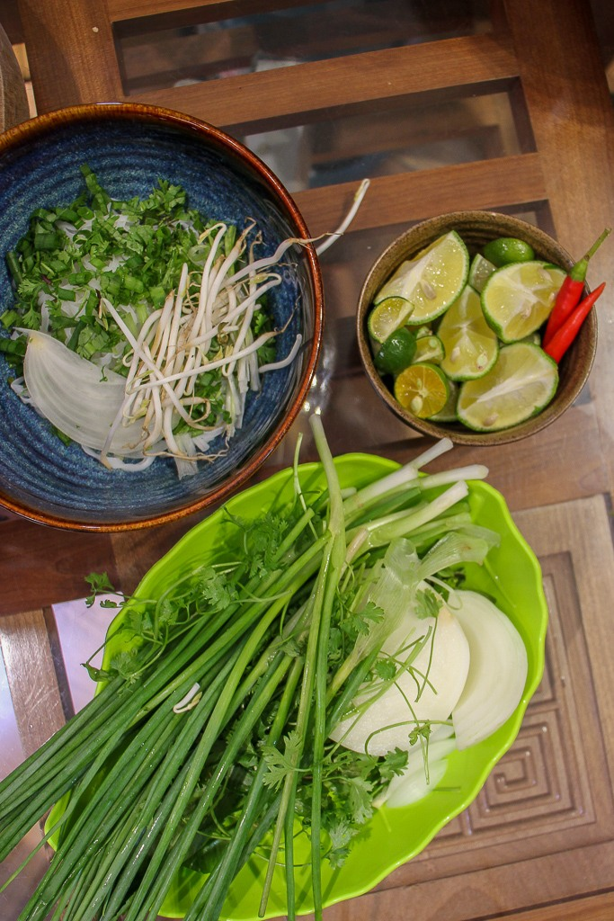 Fresh herbs and vegetables for meal at Rose Kitchen Cooking Class in Hanoi, Vietnam