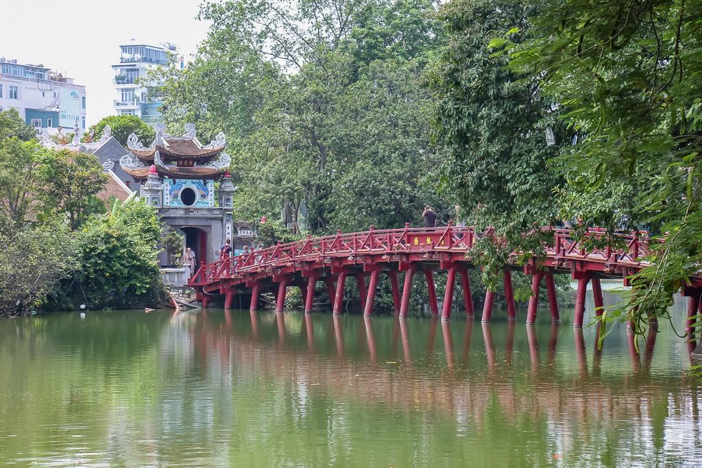 Red wooden bridge in Hanoi, Vietnam
