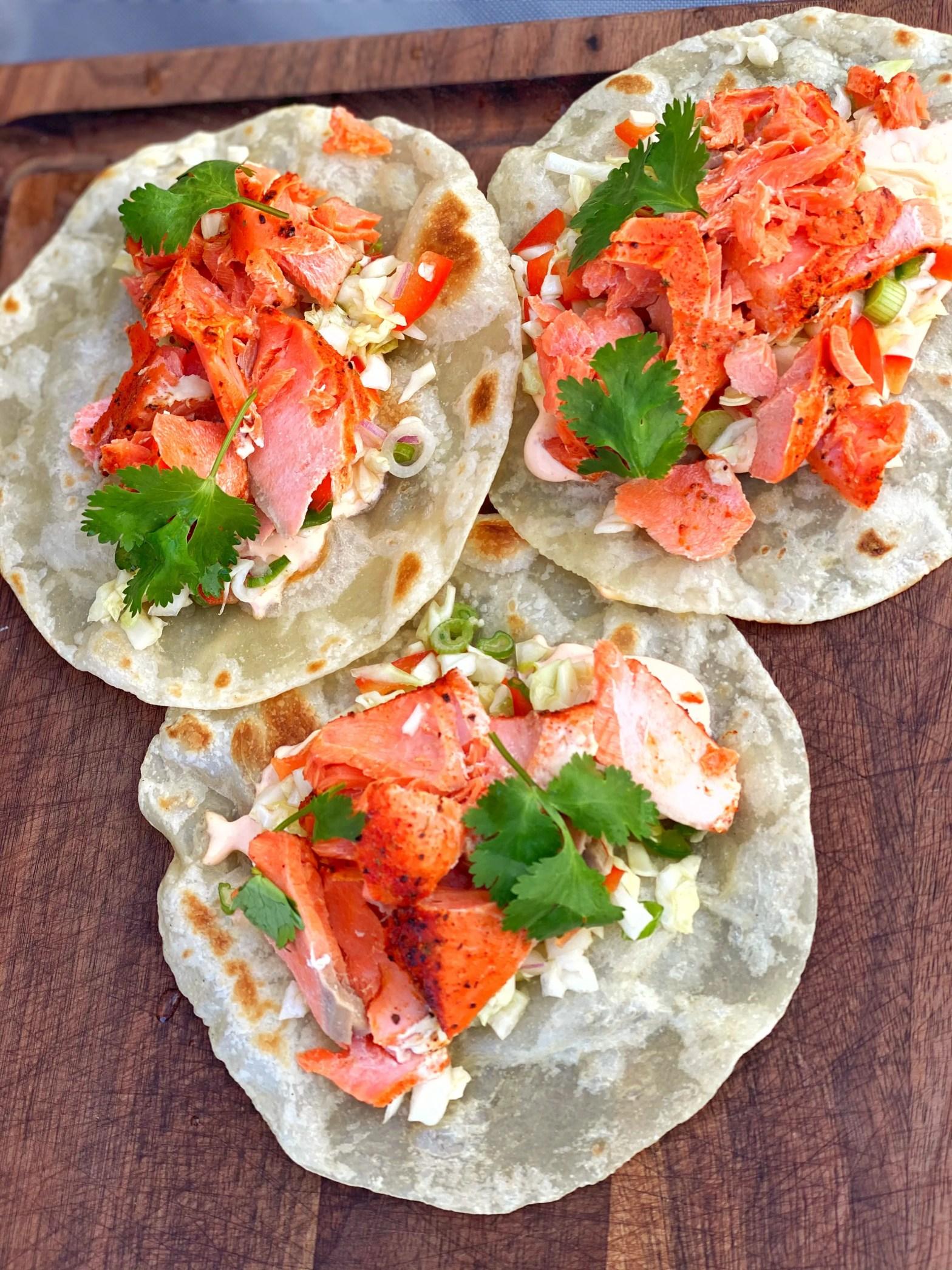 Salmon Tacos with Citrus Slaw and Sriracha Crema