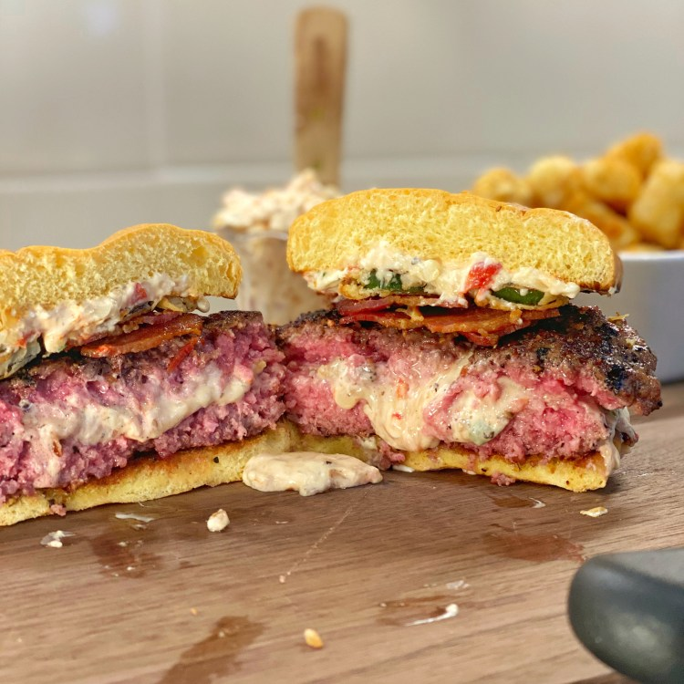 Pimento Cheese stuffed burger sliced in half
