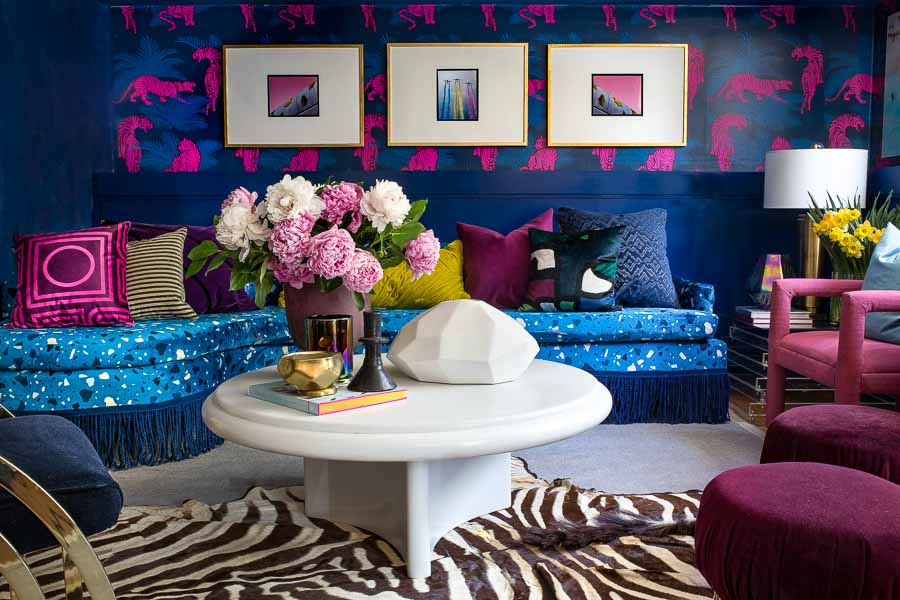 This bold combination is heaven! Living room, dramatic, blue, tiger wallpaper, wallpapered living room, terrazzo, terrazzo sofa, terrazzo fabric, Velvet, sofa with fringe, bullion, miles redd, Luke Edward hall, Wes Anderson, Karl Springer, coffee table, peonies, tiger wallpaper, spoonflower, lamps plus, fringe market, roostery
