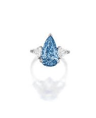 Centring on a pear-shaped fancy vivid blue diamond weighing 5.16 carats, flanked on each side by a shield-shaped diamond, mounted in platinum.
