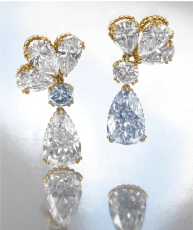 Each surmount designed as a cluster of three pear-shaped diamonds weighing 0.93, 1.07, 1.10, 1.10, 1.26 and 1.48 carats, suspending a brilliant-cut stone weighing 0.86 carat and a similarly cut fancy blue diamond weighing 0.85 carat, respectively suspending a fancy blue pear-shaped diamond weighing 5.01 carats and a similarly shaped stone weighing 5.61 carats, mounted in yellow gold.