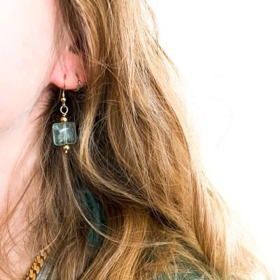 Energi øreringe med stor Ametyst set på