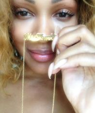Meagan Good with her Simple Script Nameplate