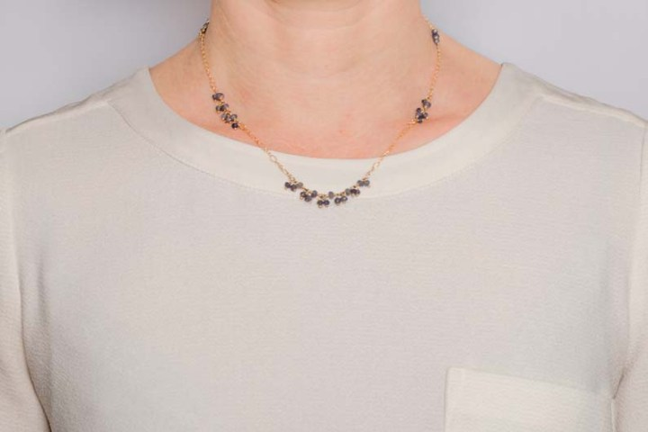 Iolite cluster and filigree necklace on model