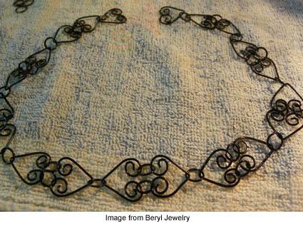 Beryl Morago's black heart wire necklace