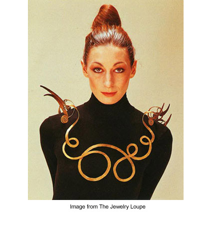 "Anjelica Huston wearing Alexander Calder's ""The Jealous Husband"" necklace made of brass wire"