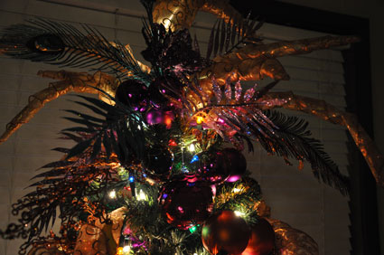 glittered leaves, feathers and ribbons spires make up the tree topper