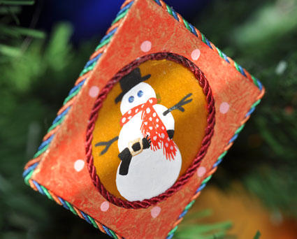 Detail of Jann's hand painted snowman with crystal blue eyes.