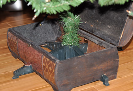 This repurposed storage box makes a great treasure box tree skirt!