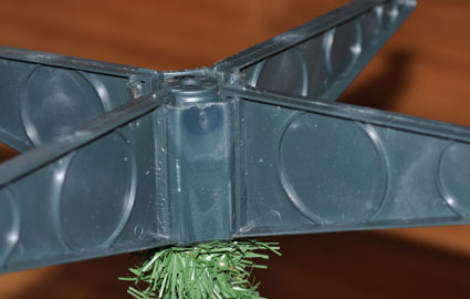 An upside down view of the tree base with built in tree stand.