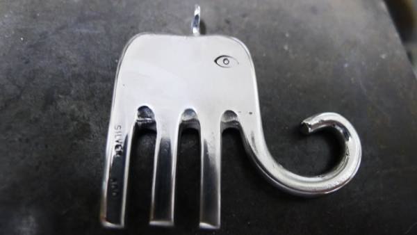 Recycled Old Forks Into Elephant Pendants