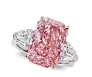 7.14-carat intense pink radiant-cut diamond is flanked by two shield-cut diamonds (1.49ctw) and mounted on platinum and 18k rose gold.