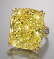 71.73-carat, cushioned-cut diamond with yellow and colorless melee in 18k yellow gold and platinum.