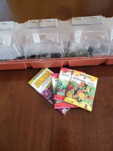 """Seed packets and an indoor mini-greenhouse """"starter kit."""""""