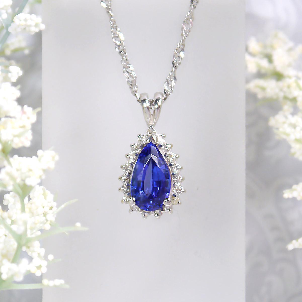 Pear Shaped Tanzanite and Diamond Halo Pendant in 14k