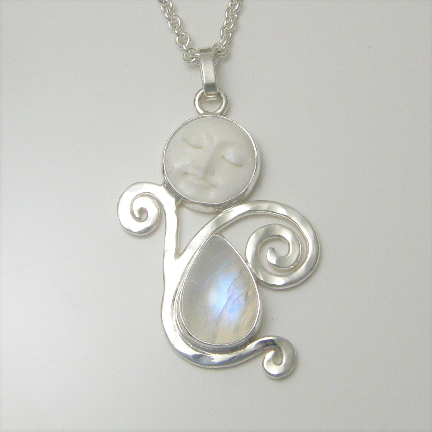 Hammered silver rainbow moonstone one of a kind queen of heaven one of a kind rainbow moonstone carved bone face hammered silver goddess pendant aloadofball Gallery