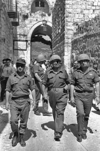 Chief of Staff Yitzhak Rabin, Defense Minister Moshe Dayan And Gen. Uzi Narkass at the entrance to the old City. Photo by Ilan Bruner via Wikimedia Commons