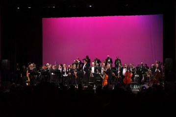 Musicians take their final bows at the conclusion of the concert