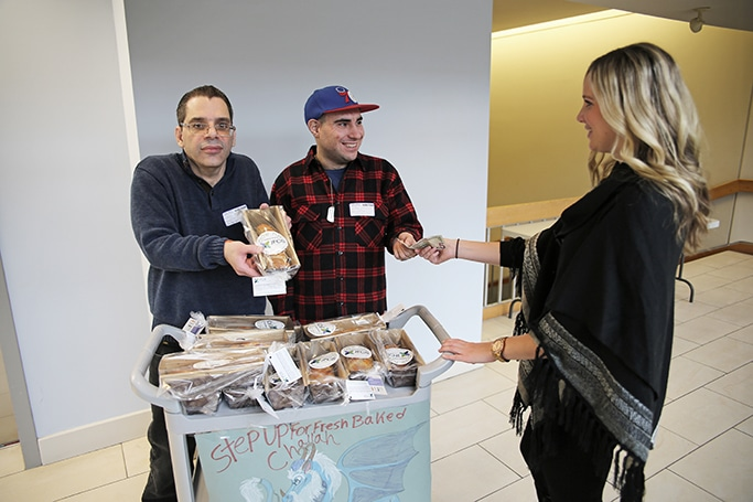 Disabled adults selling challah