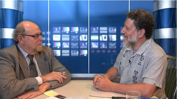"""Rabbi Address, left, chats with David Zinner, executive director of Kavod v'Nichum, an organization focused on providing traditional funeral ritual resources to the Jewish community. Zinner discusses Jewish funeral traditions in the next two episodes of """"Conversations"""" on Jewish Sacred Aging TV."""